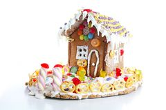 Gingerbread candy sugar house. Fairy tail candyhouse covered with snow and colorful candies Homemade gingerbread house. With colorful candy decoration stock image