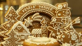 Gingerbread christmas candlestick with funny christmas sign, tree with church, houses, piggy and snowman cake beautiful. Decorated with a confectionery white stock video footage