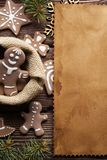 Gingerbread Christmas cookies and blank paper sheet stock image