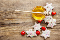 Gingerbread christmas cookies and bowl of honey on wooden table Stock Photos