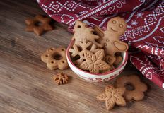Christmas cookies in bowl. Gingerbread and christmas cookies in a bowl on wooden background with a place for text royalty free stock image