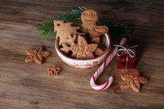 Gingerbread cookies in bowl. Gingerbread and christmas cookies in a bowl on wooden background with a place for text Royalty Free Stock Photos
