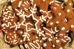 Gingerbread Christmas cookies decorated with white icing in the box stock photo