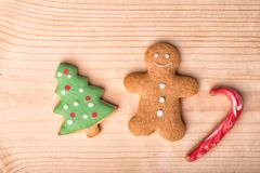 Gingerbread christmas cookies. Christmas background. Close-up. C. Gingerbread christmas cookies, ginger man, fir tree, candy red cane on a wooden background royalty free stock image