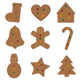 Gingerbread Christmas cookies. Set of nine Gingerbread Christmas cookies isolated on white background, various shapes. There is a snowman, a bell , a tree, a Stock Photos