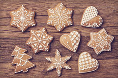 Gingerbread christmas cookies. On a wooden brown background Royalty Free Stock Photo