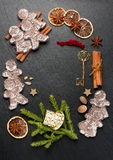 Gingerbread, Christmas decorations and spices. Royalty Free Stock Photos