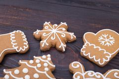 Gingerbread Christmas figures. Sweet gauntlets, Christmas tree, snowflake, shoe. Baking on a festive table stock photo