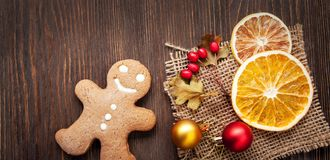 Gingerbread Christmas and gifts on table. Gingerbread Christmas and gifts on wooden table royalty free stock images
