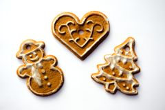 Gingerbread Christmas ornaments on white background royalty free stock photo