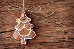 Gingerbread christmas tree. Hanging over wooden background Stock Images