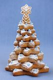 Gingerbread Christmas tree. Close-up on blue background Stock Image