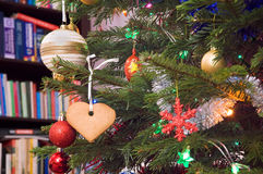 Gingerbread on christmas tree. Gingerbread and other ornaments on christmas tree royalty free stock image
