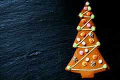 Gingerbread Christmas tree on black with space for text Royalty Free Stock Image