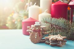 Gingerbread Christmas tree on blue table over christmas tree.  Stock Images