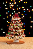 Gingerbread christmas tree with blurry lights. Gingerbread christmas tree with colorful blurry lights and warm tones Royalty Free Stock Images
