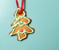 Gingerbread Christmas tree cookie over blue background Stock Photos