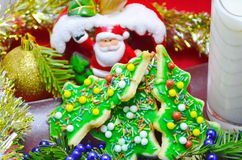 Gingerbread christmas tree cookies. Homemade gingerbread christmas tree cookies and milk with seasonal background Royalty Free Stock Photo