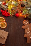 Gingerbread Christmas tree and gifts on table Royalty Free Stock Image