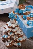 Gingerbread Christmas tree and gingerbread men. In the box Stock Photography
