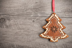 Gingerbread christmas tree. Hanging over wooden background Stock Photo