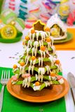 Gingerbread Christmas tree and house. Served Gingerbread Christmas tree and house royalty free stock photos