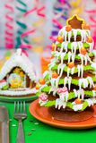 Gingerbread Christmas tree and house. Served Gingerbread Christmas tree and house stock photography