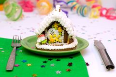Gingerbread Christmas tree and house. Gingerbread Christmas house served for holiday dinner royalty free stock photos