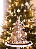 Gingerbread Christmas tree. On real fir tree background Stock Photo