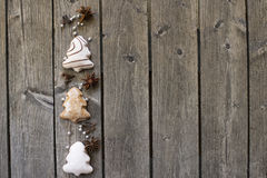 Gingerbread christmas trees and spices on boards Royalty Free Stock Photos