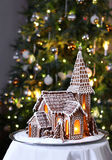 Gingerbread church Christmas tree background Stock Photos