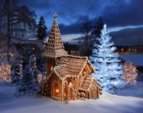 Gingerbread church with lit Christmas tree. On Xmas night royalty free stock photos