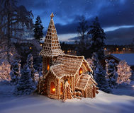 Gingerbread church on snowy Christmas night landscape. Gingerbread church snowy Christmas night Stock Photo