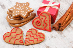 Gingerbread with cinnamon and gifts for Christmas on old wooden background, christmas time Royalty Free Stock Images