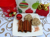Gingerbread, cinnamon sticks, gift boxes and Christmas decorations Stock Photography