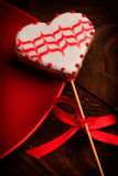 Gingerbread coockie. Heart shaped gingerbread coockie on wooden table Royalty Free Stock Photo