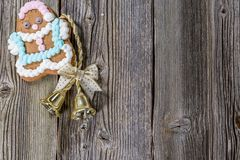 Gingerbread Cookie and bell on old wood. En Table. Christmas Still Life Photo Royalty Free Stock Photo