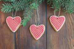 Traditional Christmas gingerbread with a glaze on a wooden background stock photography