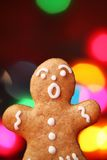 Gingerbread cookie. Close-up of Christmas gingerbread cookie with blurred lights background royalty free stock photo