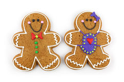 Gingerbread Cookie Couple. Gingerbread cookie family isolated on white stock images