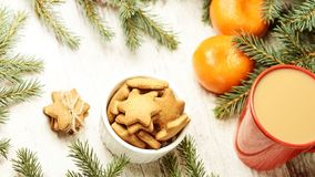 Gingerbread Cookie. Cup of coffee. Spruce branch. Orange tangerines. NewYear.  royalty free stock photography