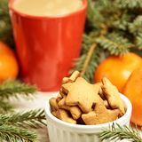 Gingerbread Cookie. Cup of coffee. Spruce branch. Orange tangerines. New Year royalty free stock photo