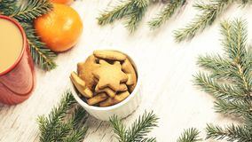 Gingerbread Cookie. Cup of coffee. Tangerines. NewYear mood.  royalty free stock photos