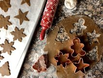 Gingerbread cookie cutouts. Top view of gingerbread cookie preparations stock image