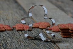 Gingerbread Cookie and Cutter Royalty Free Stock Photo