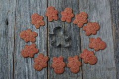 Gingerbread Cookie and Cutter Stock Image