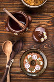 Gingerbread cookie decoration, honey pot, bowl with cornflakes Stock Image