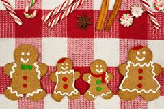 Gingerbread cookie family on a red and white checked cloth Stock Image