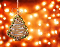Gingerbread cookie hanging over a bokeh background in a christ Stock Photography