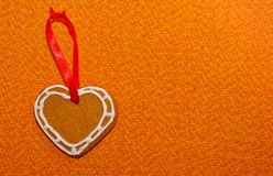 Gingerbread cookie heart with decorative ribbon Royalty Free Stock Photo